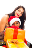 Beautiful woman with boy and Christmas gifts Stock Photo