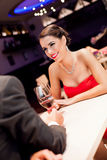 Beautiful woman with boyfriend in restaurant Stock Images
