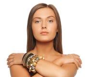 Beautiful woman with bracelets Stock Image