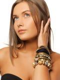 Beautiful woman with bracelets Stock Photo