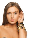 Beautiful woman with bracelets stock photos
