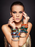 Beautiful woman in bracelets Stock Images