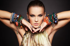 Beautiful woman in bracelets Royalty Free Stock Image