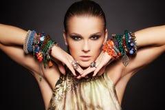 Beautiful woman in bracelets Royalty Free Stock Image