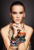 Beautiful woman in bracelets Stock Photos