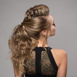 Beautiful woman. Braid Tail Hairstyle. Studio Royalty Free Stock Image