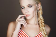 Beautiful woman with braided hair, make up and manicure royalty free stock photo