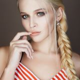 Beautiful woman with braided hair, make up and manicure royalty free stock image