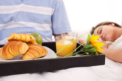 Beautiful woman with breakfast in bed. Beautiful women sleeping with breakfast in bed stock photography