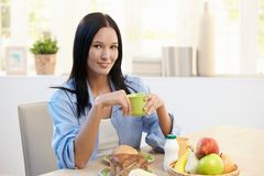 Beautiful woman at breakfast table Stock Photos