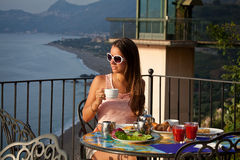 Beautiful woman with breakfast Royalty Free Stock Images