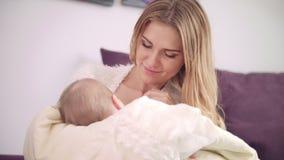 Beautiful woman breast feeding baby. Cheerful mom enjoy breastfeeding stock footage