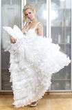 The beautiful woman, the bride, near wedding dress dreams about wedding Stock Image