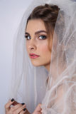 Beautiful woman  bride with tiara on head. On bright background , copy space Royalty Free Stock Images