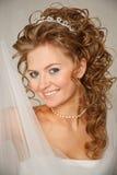 Beautiful woman-bride with  a veil. Stock Photos