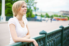 Beautiful woman on the bridge Stock Image