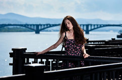 Beautiful woman with bridge city background Stock Image