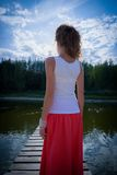 Beautiful woman on bridge on Lake Royalty Free Stock Image