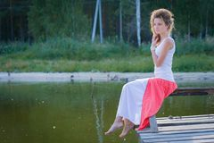 Beautiful woman on bridge on Lake Royalty Free Stock Photo