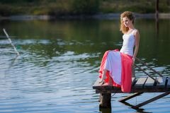 Beautiful woman on bridge on Lake Royalty Free Stock Images