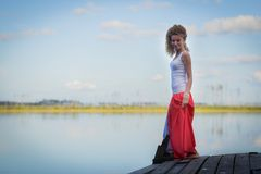 Beautiful woman on bridge on Lake Royalty Free Stock Photography