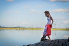 Beautiful woman on bridge on Lake Royalty Free Stock Photos