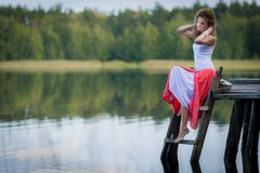 Beautiful woman on bridge on Lake Stock Image