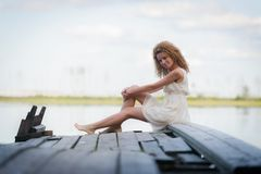 Beautiful woman on bridge on Lake Stock Photo