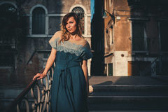 Beautiful woman on a bridge in Venice, Italy Stock Photos