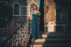 Beautiful woman on a bridge in Venice, Italy Royalty Free Stock Photography