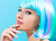 Beautiful woman in a bright blue wig Stock Photography