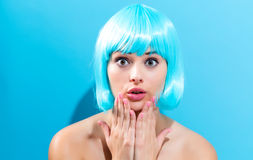 Beautiful woman in a bright blue wig Stock Photo