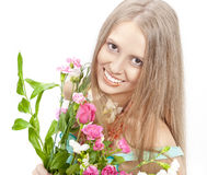 Beautiful woman with bright color flowers Stock Photos