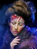 Beautiful woman with bright creative make up Stock Photo