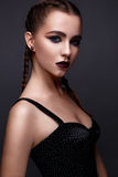 Beautiful woman with bright creative make-up. Model with braids and lip color marsala. Stock Photos