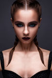 Beautiful woman with bright creative make-up. Model with braids and lip color marsala. Stock Image