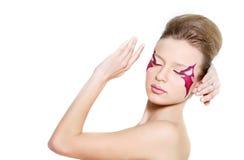 Beautiful woman with bright face art visage Stock Photos