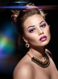 Beautiful woman with bright fashion make up Stock Images