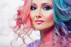Beautiful woman with bright hair. Bright hair color, hairstyle with curls. royalty free stock photos