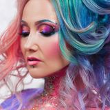 Beautiful woman with bright hair. Bright hair color, hairstyle with curls. stock images