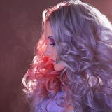 Beautiful woman with bright hair. Bright hair color, hairstyle with curls. royalty free stock image