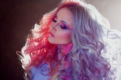 Beautiful woman with bright hair. Bright hair color, hairstyle with curls. royalty free stock photography