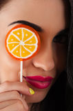 Beautiful woman and a bright lollipop Stock Image