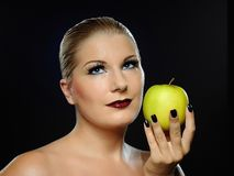Beautiful woman with bright make-up,apple Royalty Free Stock Photo