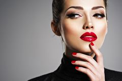Beautiful woman with bright make-up and red nails. royalty free stock photo