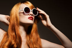 Beautiful woman with bright make-up and sunglasses Stock Image