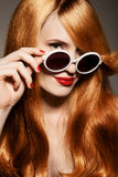 Beautiful woman with bright make-up and sunglasses Stock Photography