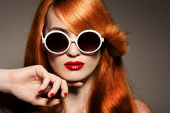 Beautiful woman with bright make-up and sunglasses Royalty Free Stock Image