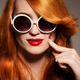 Beautiful woman with bright make-up and sunglasses Royalty Free Stock Images