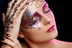 Beautiful woman with bright makeup with glitter Stock Photo